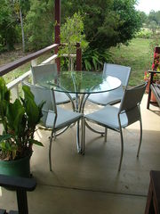 glass & chrome table with 4 white chairs
